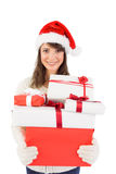 Attractive woman wearing santa hat with gifts Royalty Free Stock Photography