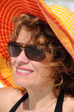 Attractive Woman wearing Summer Hat Stock Image