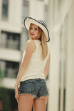 Attractive woman wearing sun hat and white top Stock Photography