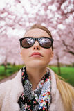 Attractive woman wearing sunglasses at spring park Stock Photos
