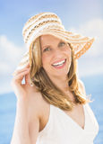 Attractive Woman Wearing Sunhat At Beach Royalty Free Stock Photos
