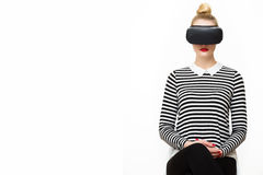 Attractive woman wearing virtual reality glasses. VR headset. Virtual reality concept on white Royalty Free Stock Photo