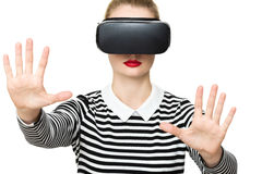 Attractive woman wearing virtual reality goggles. Unusual double exposure virtual reality concept. Royalty Free Stock Photography