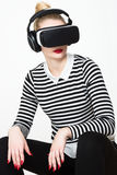 Attractive woman wearing virtual reality goggles. VR headset. Virtual reality concept on white background royalty free stock photography