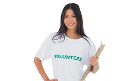 Attractive woman wearing volunteer tshirt holding clipboard Stock Photo