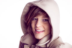 Attractive woman wearing a warm coat with hood raised Stock Images