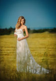 Attractive woman wearing white long dress posing outdoor Royalty Free Stock Photo