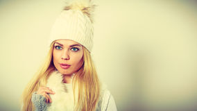 Attractive woman wearing winter clothes. Stock Photos