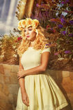 Attractive woman wearing wreath of yellow flowers Royalty Free Stock Images