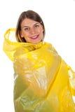 Attractive woman wearing yellow raincoat - isolated. Picture of attractive caucasian woman wearing a yellow raincoat, posing on isolated background Royalty Free Stock Photo