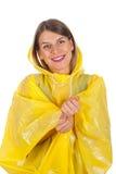 Attractive woman wearing yellow raincoat - isolated Stock Photo
