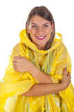 Attractive woman wearing yellow raincoat - isolated. Picture of attractive caucasian woman wearing a yellow raincoat, posing on isolated background Royalty Free Stock Photography