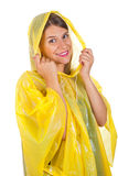 Attractive woman wearing yellow raincoat - isolated. Picture of attractive caucasian woman wearing a yellow raincoat, posing on isolated background Royalty Free Stock Images