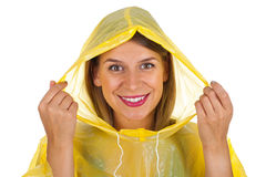 Attractive woman wearing yellow raincoat - isolated Royalty Free Stock Images