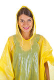 Attractive woman wearing yellow raincoat - isolated. Picture of attractive caucasian woman wearing a yellow raincoat, posing on isolated background Royalty Free Stock Image
