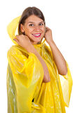 Attractive woman wearing yellow raincoat - isolated Royalty Free Stock Photo