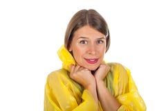 Attractive woman wearing yellow raincoat - isolated. Picture of attractive caucasian woman wearing a yellow raincoat, posing on isolated background Royalty Free Stock Photos