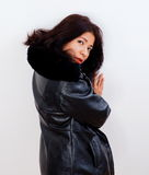 Attractive woman wears leather jacket Royalty Free Stock Image