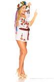 Attractive woman wears Ukrainian dress behind white board Stock Image