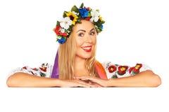 Attractive woman wears Ukrainian dress behind white board Royalty Free Stock Image
