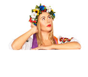 Attractive woman wears Ukrainian dress behind white board Royalty Free Stock Photography