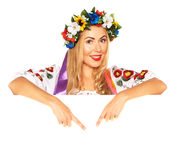 Attractive woman wears Ukrainian dress behind white board Stock Photos