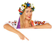 Attractive woman wears Ukrainian dress behind white board Royalty Free Stock Image