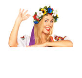 Attractive woman wears Ukrainian dress behind white board Royalty Free Stock Photos