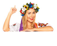 Attractive woman wears Ukrainian dress behind white board Royalty Free Stock Images