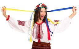 Attractive woman wears Ukrainian national dress. Is holding ukrainian flag isolated on white background stock photos