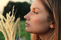 Attractive Woman with wheat spikes Stock Photography