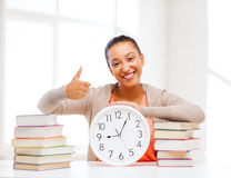 Attractive woman with white clock Royalty Free Stock Photos