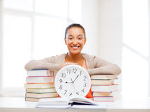 Attractive woman with white clock Royalty Free Stock Photo