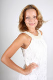 Attractive woman in white dress Stock Photos