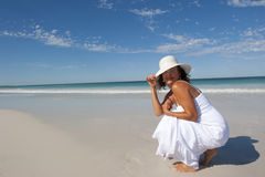 Attractive Woman in White Dress on Beach Stock Image