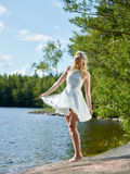 Attractive woman and white dress Stock Image