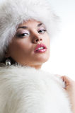 Attractive woman in white fur Royalty Free Stock Image