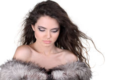Attractive woman in white and gray fur coat Royalty Free Stock Photos