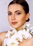 Attractive Woman and White Orchid Stock Photo