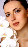 Attractive Woman and White Orchid Stock Image