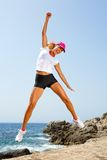 Attractive woman with winning attitude jumping. Royalty Free Stock Images