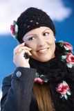 Attractive woman in winter clothes with mobile Royalty Free Stock Images