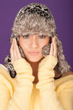 Attractive woman in winter hat. Attractive young woman wearing a fur trimmed winter hat pulled closely around he face keeping away the winter cold Stock Photo