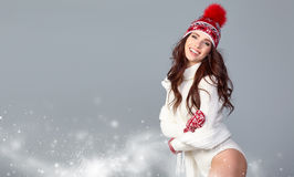 Attractive woman in winter wool cap on grey background Royalty Free Stock Photography