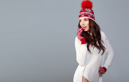 Attractive woman in winter wool cap on grey background Royalty Free Stock Photo