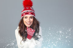 Attractive woman in winter wool cap on grey background Royalty Free Stock Photos