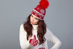 Attractive woman in winter wool cap on grey background Stock Image