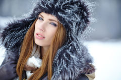 Attractive  woman in wintertime outdoor Royalty Free Stock Image