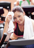 Attractive woman wiping her face after exercises Stock Image
