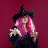 Attractive woman in witches hat and costume with red hair. Halloween Stock Photos